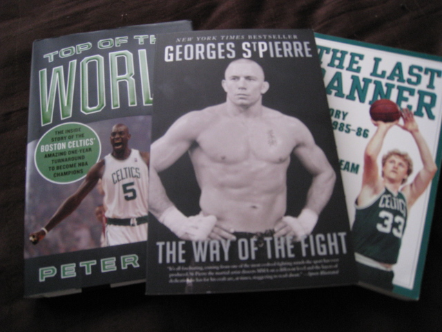 """The Way of the Fight"" by GSP, a champion, surrounded by two books about other champions!"